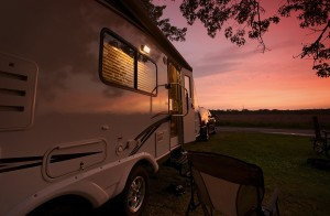 bigstock-Travel-Trailer-In-Sunset-50763101